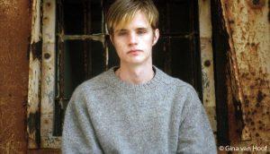Portrait picture of Matthew Shepard wearing a gray sweater.